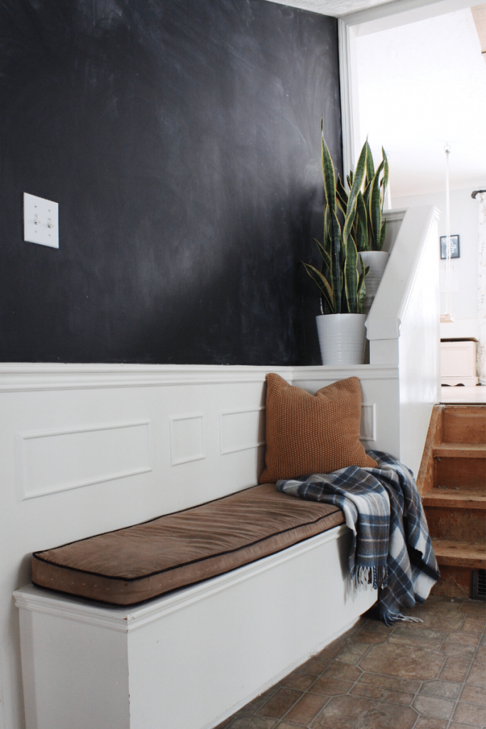 built in bench with chalkboard wall above the bench