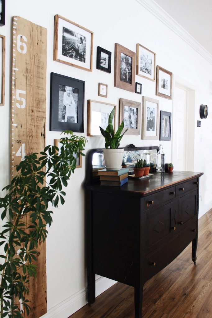 use antique furniture to store linenes when there is no linen closet