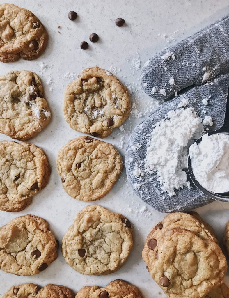 Gluten Free Chocolate Chip Cookies beside oven mit with spilt flour