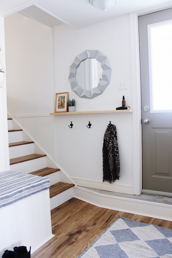 updated hallway with white paint and new stairs