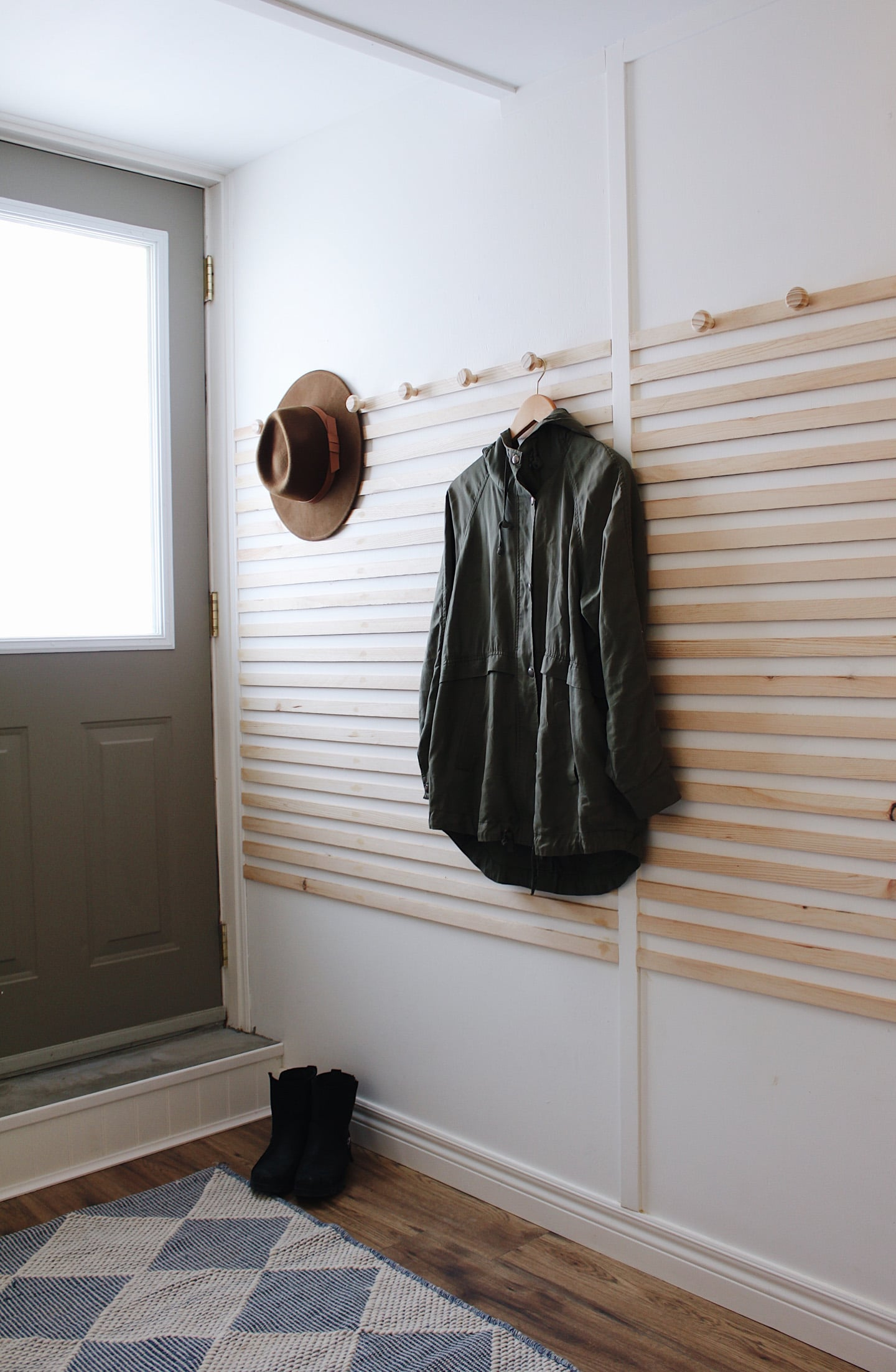 accent wall with coat hooks