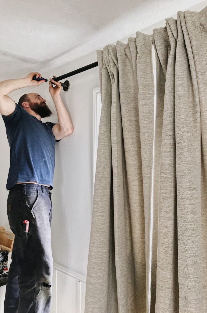 adding curtain rod to wall