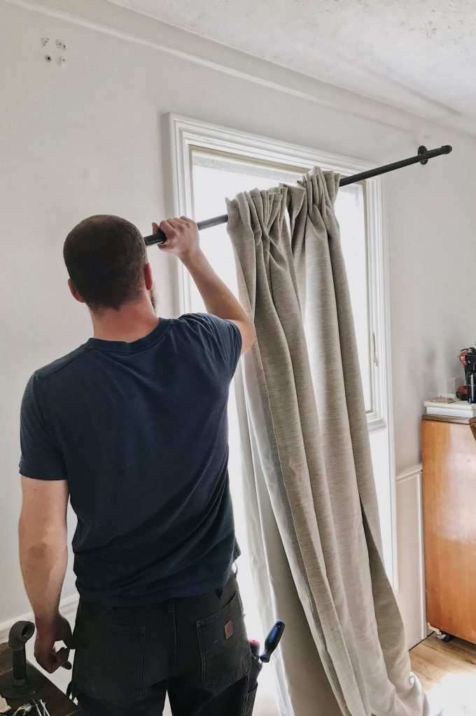 adding curtains to curtain rod