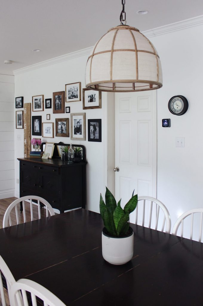 light fixture over a dining room table