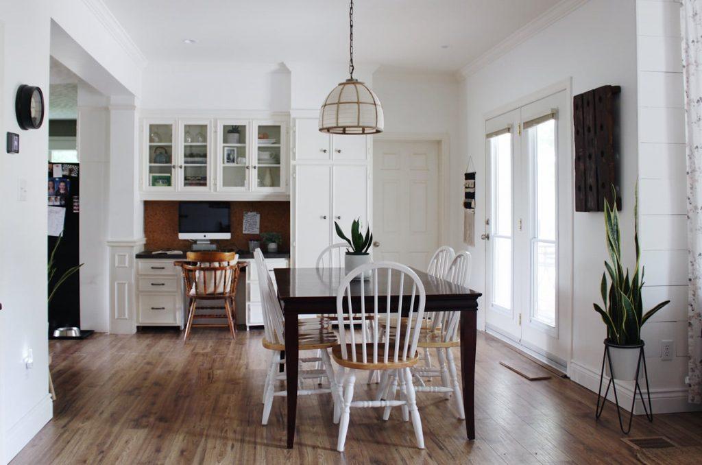 walkthrough dining room with kitchen around the corner