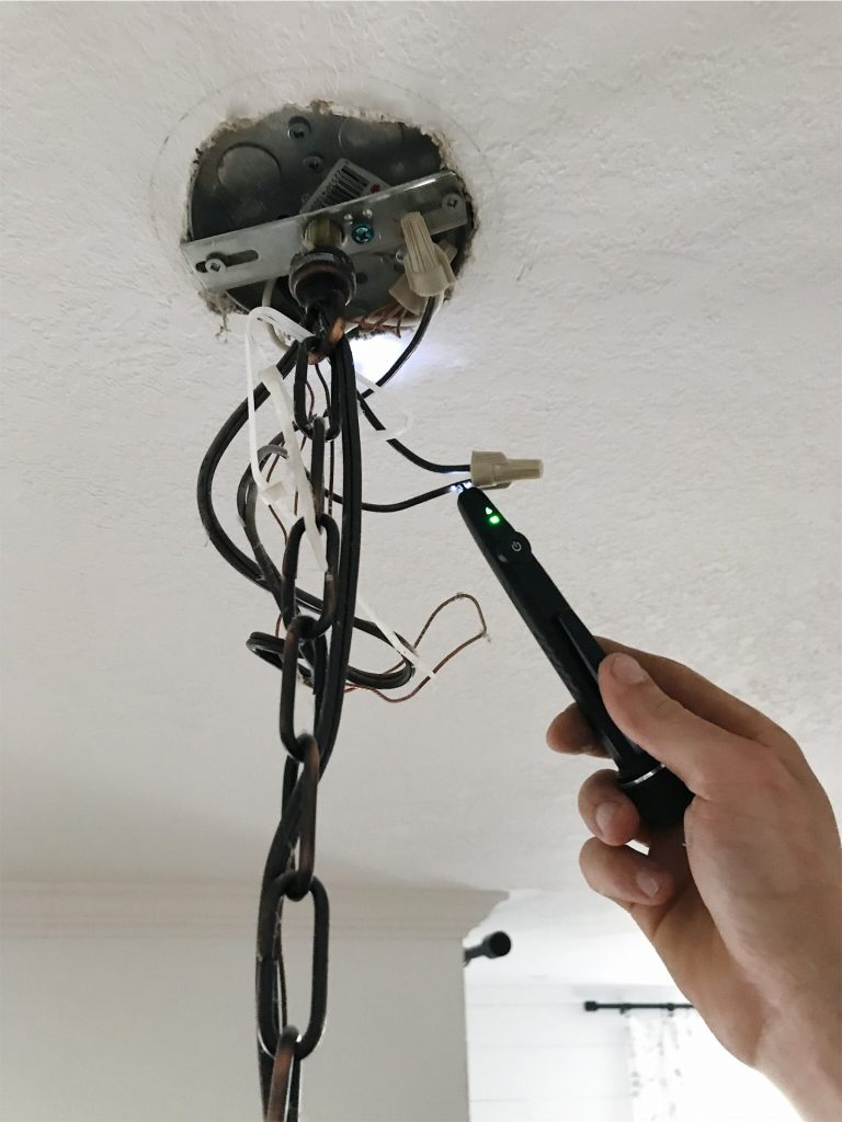 texting light fixture for power with proximity tester
