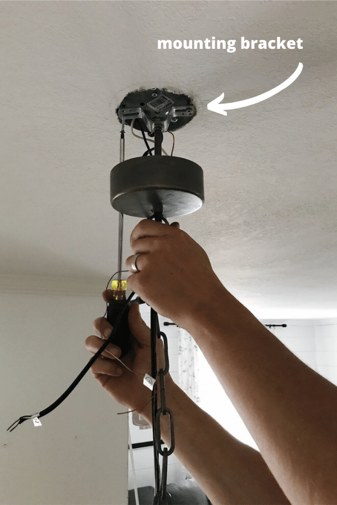 installing light fixture mounting bracket