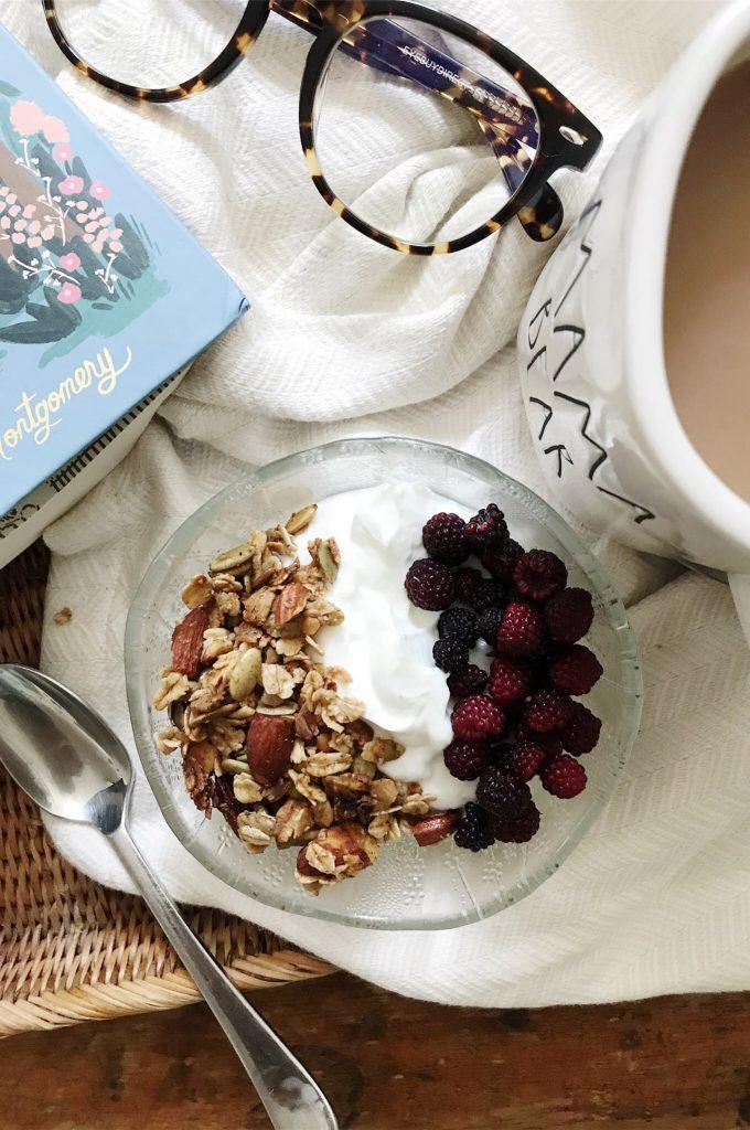 gluten-free granola and raspberries on greek yogurt