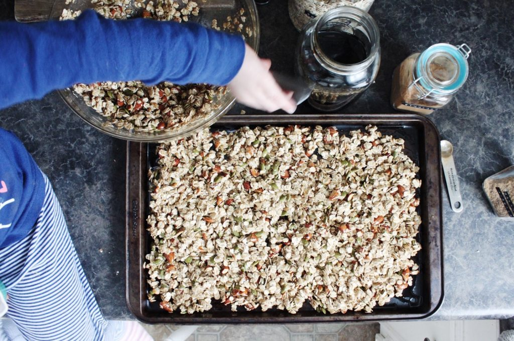 gluten-free granola on pan reading for oven