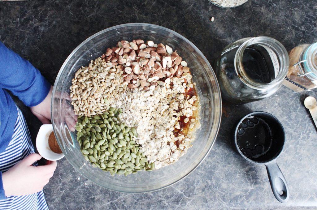 gluten-free granola ingredients in mixing bowl