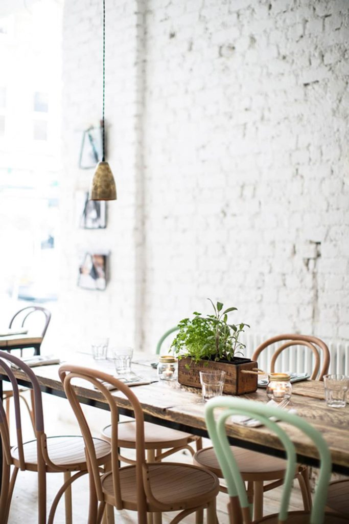 textured brick wall in dining room