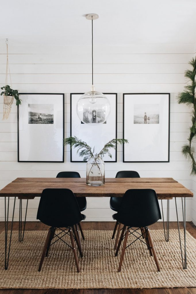 large photograph behind dining room table