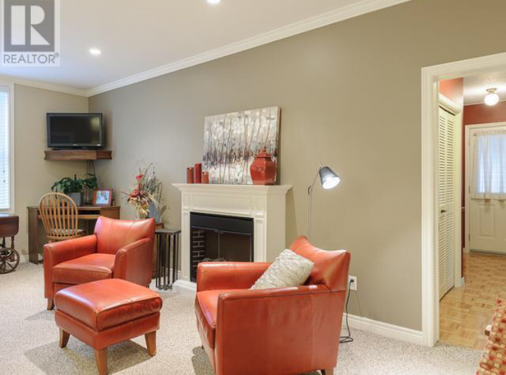 living room with sitting area near fireplace