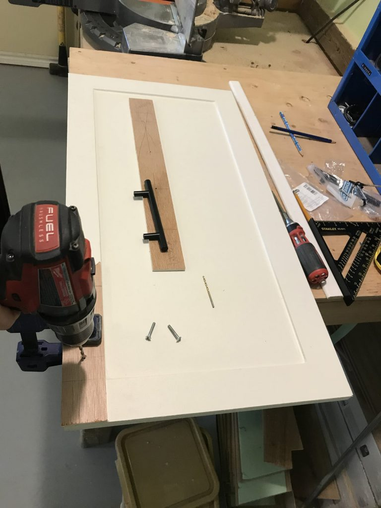 installing cabinet hardware with template