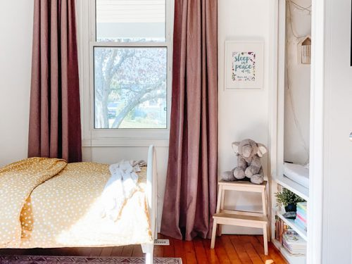 bedroom with wooden curtain rod