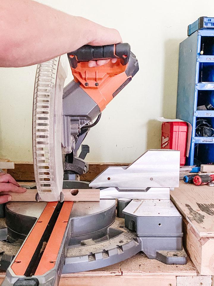 chop saw cutting wooden dowel