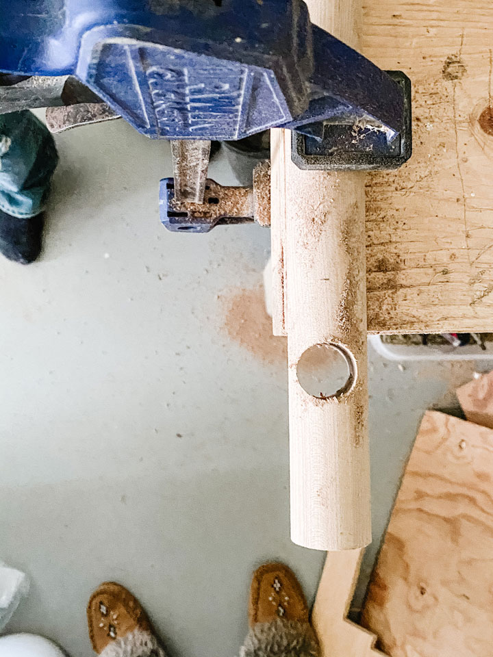 showing hole in wooden dowel for curtain rod