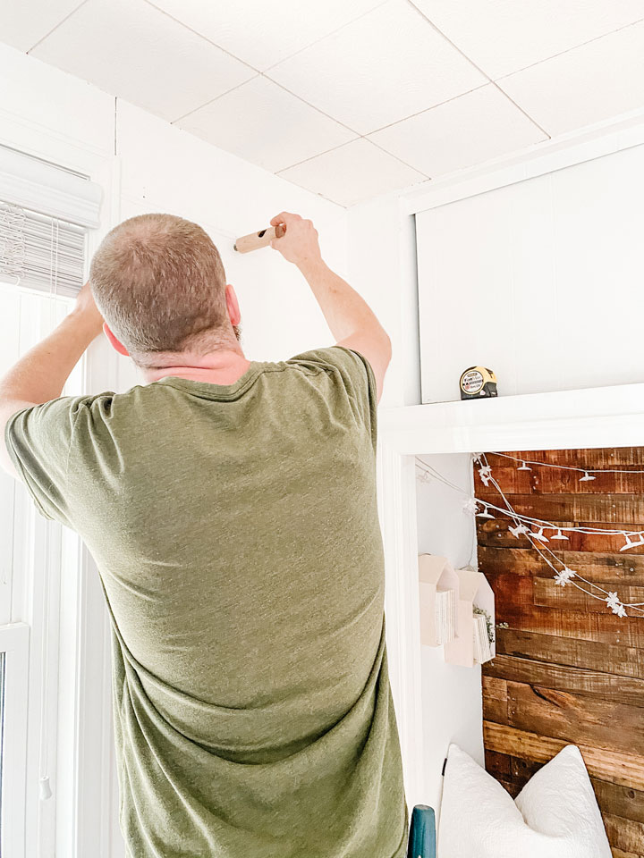 installing curtain rod bracket into wall