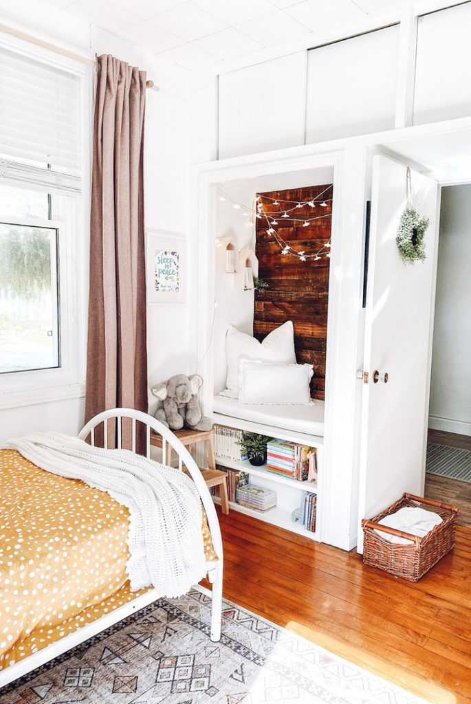 kids bedroom looking at reading nook built in to the closet updates beginners can make to their home
