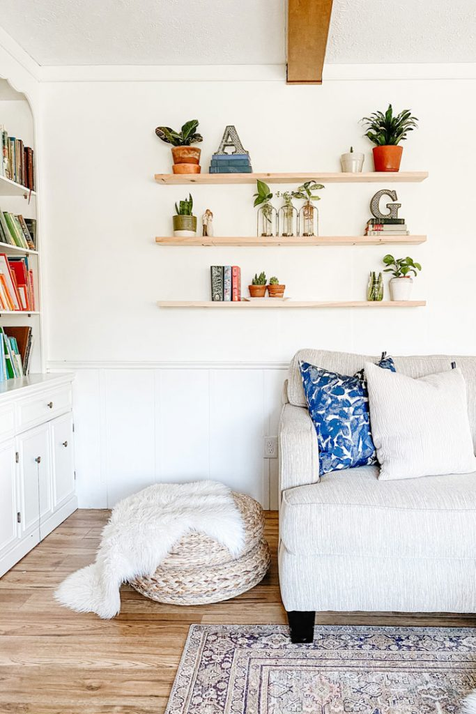 floating shelves above living room couch