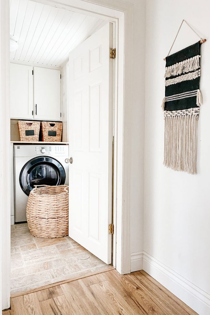 open door looking into updated laundry room updates beginners can make to their home