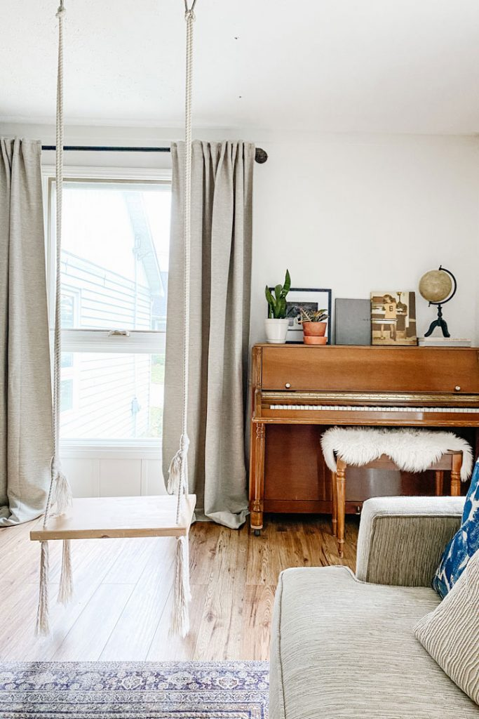 piano sitting the window with a swing hanging infront of the window updates beginners can make to their home