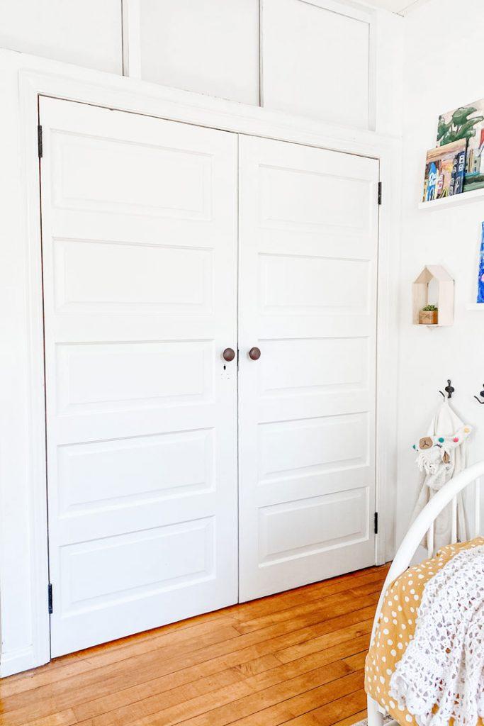 salvaged doors for closet installed with doorknobs