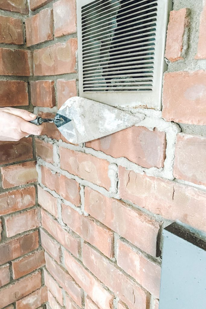 smoothing mortar with pointing trowel