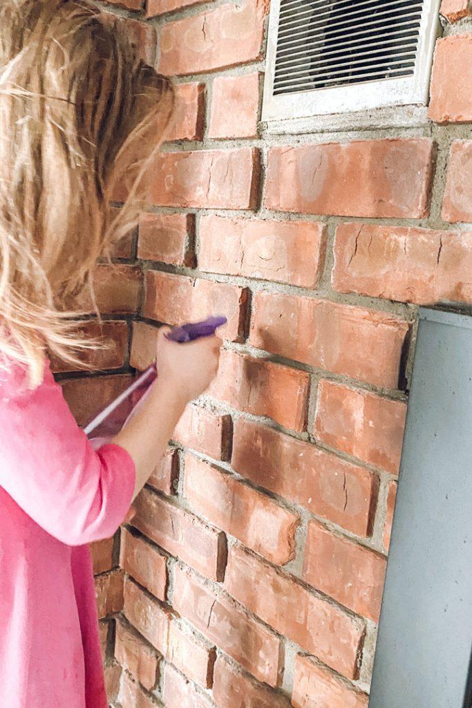 spraying brick with water
