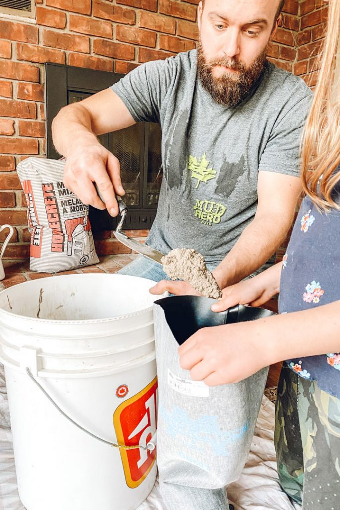 adding mortar to grout bag