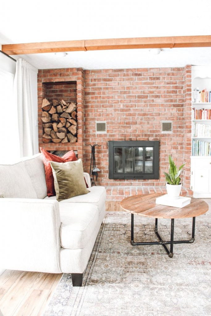 updated fireplace insert on red brick fireplace