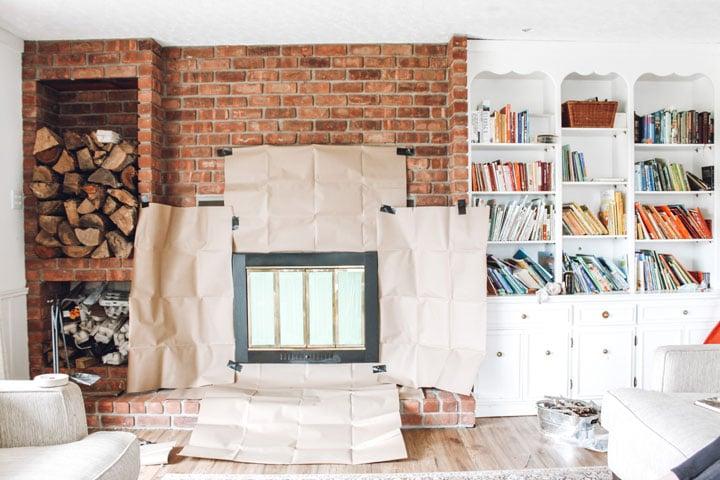 kraft paper around fireplace insert to protect brick