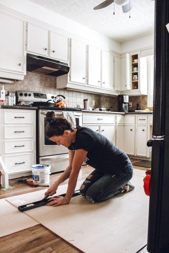 cutting beadboard on kitchen floor