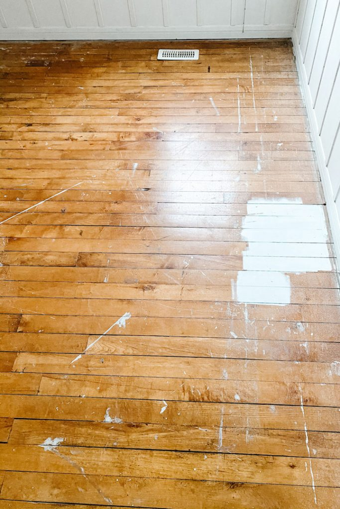 close up of hardwood floors with paint splats