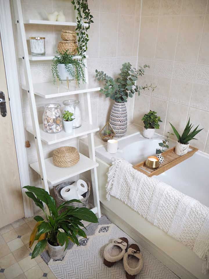 no linen closet in a small home means bringing the storage into the bathroom with tiered storage