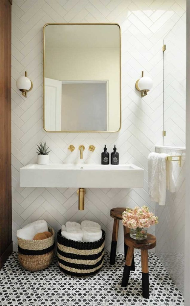 baskets under bathroom sink perfect for when there is no linen closet