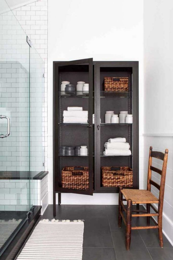 a glass cabinet can be a great use of space in the bathroom when you are looking for more storage