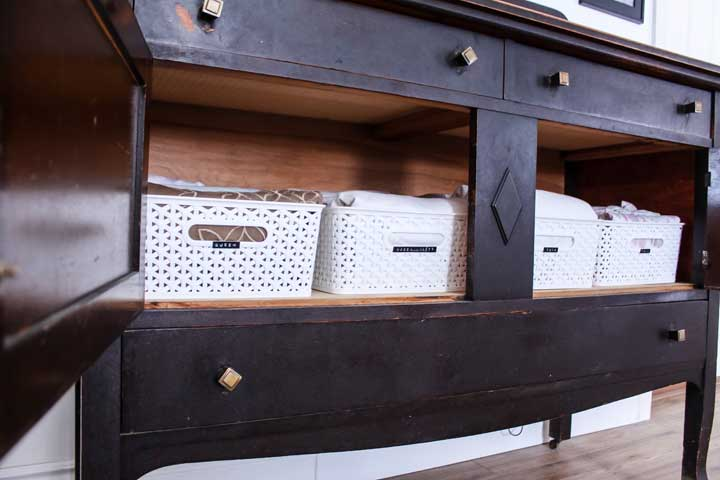 no linen closet solution. storing lines in antique furniture outside the bathroom