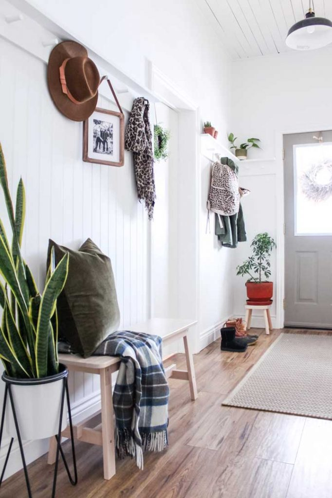 Bright, white entryway without closet