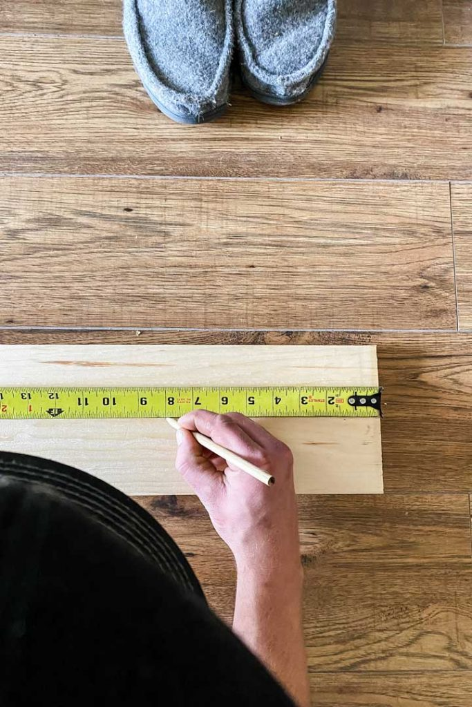 measure 1x6 pine boards 8 inches apart for pegs