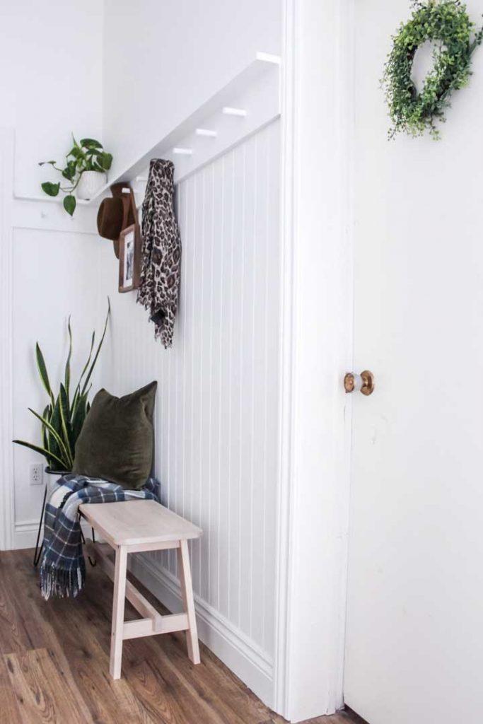 DIY White modern peg rail shelf in front entryway
