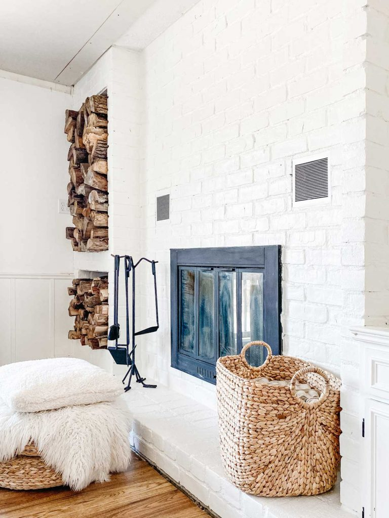 how to paint a brick fireplace complete white brick with wood storage and basket for fire started storage