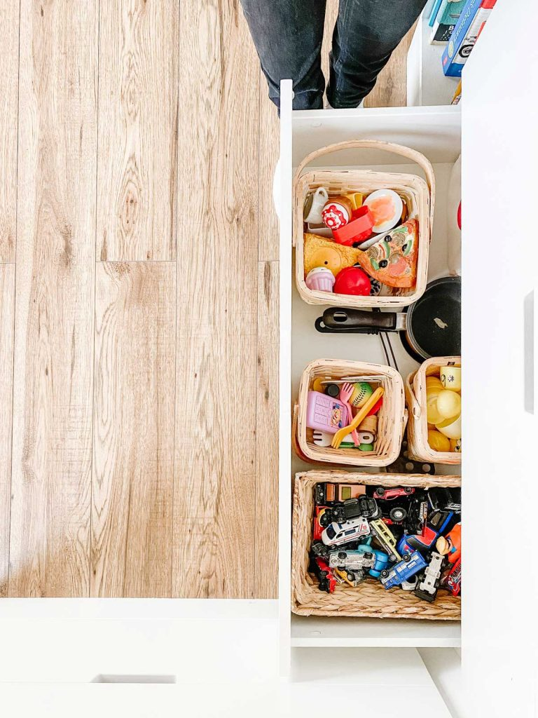 toy storage solution in baskets inside built-in drawers